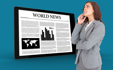 Worried businesswoman against digital tablet and smartphone showing news photo