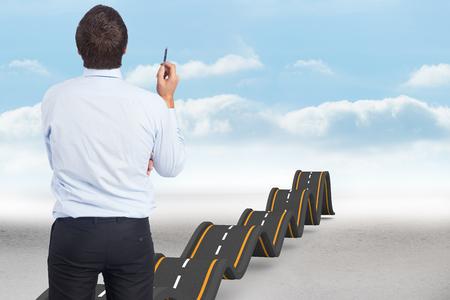 bumpy: Thinking businessman holding pen against bumpy road backdrop