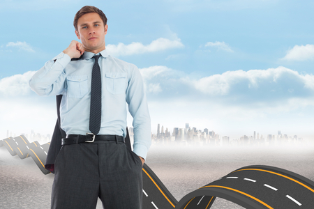 bumpy road: Serious businessman holding his jacket against bumpy road backdrop Stock Photo
