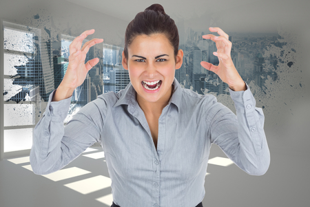 Furious businesswoman gesturing against splash showing cityscape photo