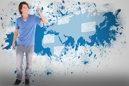 Handsome guy pointing against splash on wall revealing email graphic photo