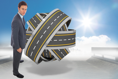 tangled roads: Serious businessman standing against tangled roads in a ball
