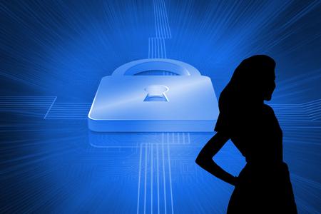 lock  futuristic: Composite image of lock on futuristic blue background Archivio Fotografico