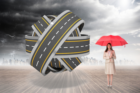 tangled roads: Attractive businesswoman holding red umbrella against tangled roads in a ball