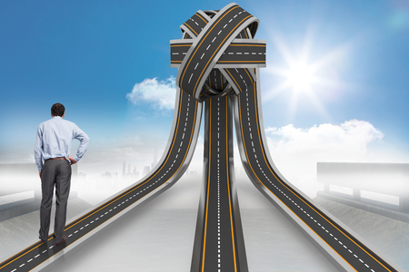 tangled roads: Businessman with hand on hip against tangled roads in a ball Stock Photo