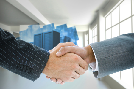 Composite image of business handshake against futuristic shiny arrow photo