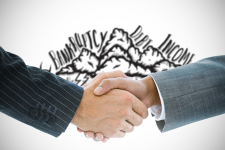 Composite image of business handshake against hexagons on blue background photo