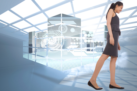 holographic: Asian businesswoman walking against room with holographic cloud