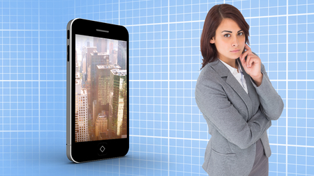 Focused businesswoman against blue background with grid photo