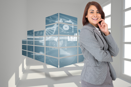 Happy businesswoman against white room with windows photo