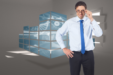 Thinking businessman tilting glasses against digitally generated room with bordered up window photo