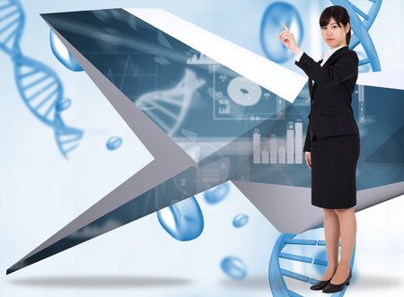 Focused businesswoman pointing against blue chromosomes on blue background photo