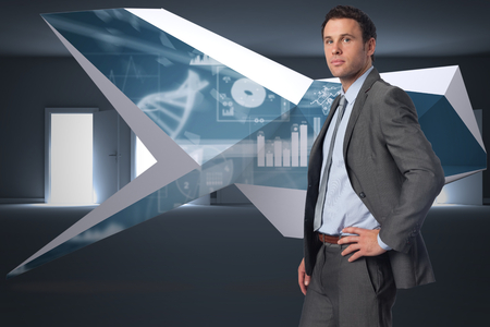Serious businessman with hand on hip against many doors opening revealing light photo