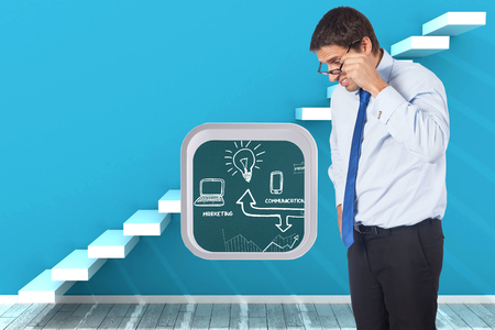 Thinking businessman tilting glasses against steps in a blue room photo