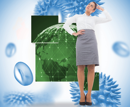 Focused businesswoman against blue virus cells photo