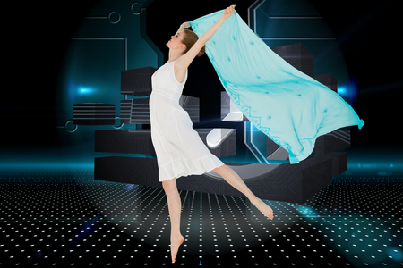 Young beautiful female dancer with blue scarf against doorway on technological black background photo