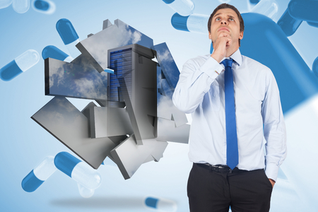 Thinking businessman touching his chin against blue pills floating photo