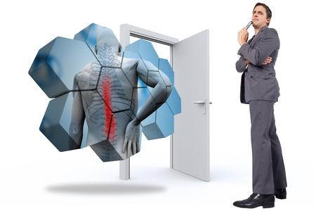 Thinking businessman holding glasses against door opening photo