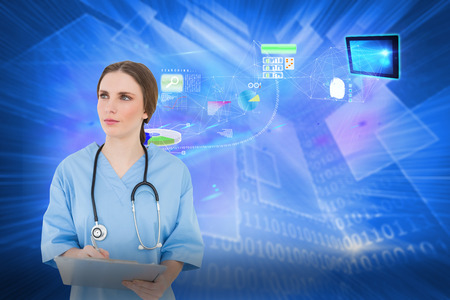 Thoughtful female doctor holding a clipboard against shiny technological background photo