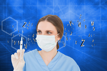 Pretty brunette female doctor holding a syringe and looking at it against abstract technology background photo