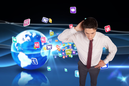 scratching head: Thinking businessman scratching head against digital earth background