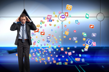 light brown hair: Stressed businessman with hands on head against arrow on technological background Stock Photo