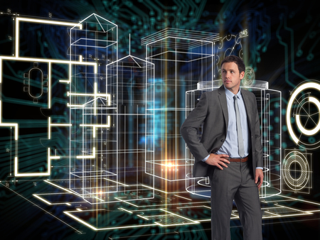 light brown hair: Serious businessman with hand on hip against shiny key on black circuit board background