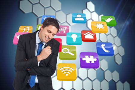 light brown hair: Thinking businessman holding pen against technological background with hexagons