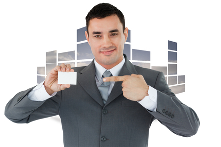 businesscard: Businessman pointing at his businesscard against structure showing sky Stock Photo