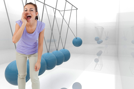 Young female shouting against blue newtons cradle photo