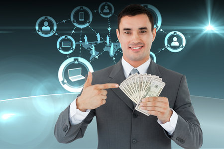 Businessman pointing at bank notes in his hand against online community background photo