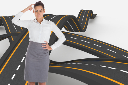 bumpy: Focused businesswoman against bumpy road background