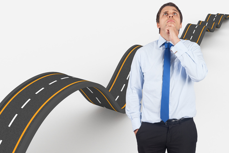 Thinking businessman touching his chin against bumpy road background photo