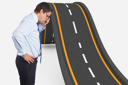 bumpy road: Thinking businessman tilting glasses against bumpy road background