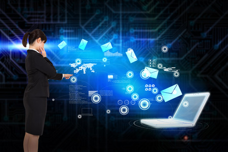 Businesswoman pointing against futuristic black and blue background photo