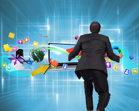 outstretched: Businessman posing with arms outstretched against multiple geometric lights Stock Photo