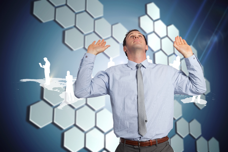 Businessman standing with arms pressing up against technological background with hexagons photo