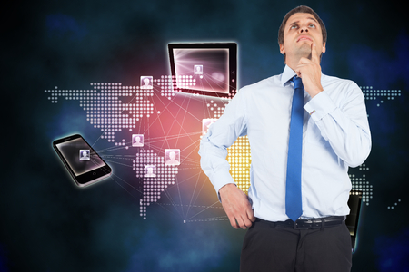 Thinking businessman touching his chin against global connection background photo