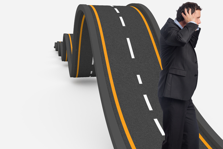 bumpy road: Stressed businessman with hands on head against bumpy road background
