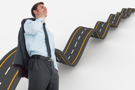 bumpy road: Smiling businessman holding his jacket against bumpy road background Stock Photo