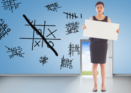 Businesswoman holding a placard against brainstorm on blue wall with open door photo