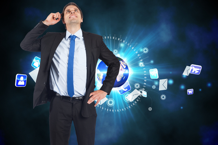 scratching head: Thinking businessman scratching head against global communication background Stock Photo