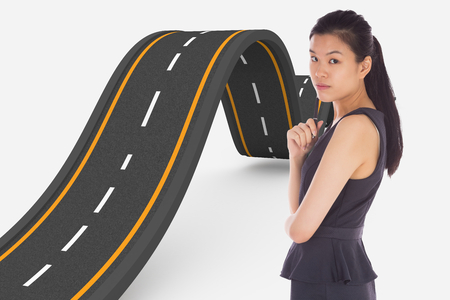 bumpy: Thoughtful businesswoman against bumpy road background