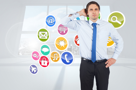 scratching head: Thinking businessman scratching head against computing application icons
