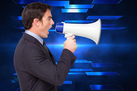 Profile of a businessman shouting through a megaphone against abstract technology background photo