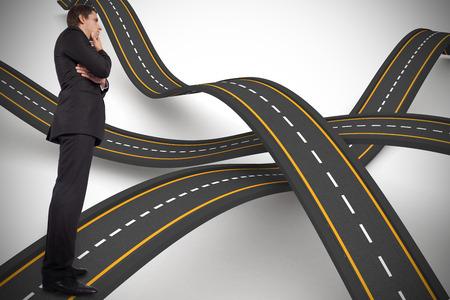 bumpy: Thinking businessman touching chin against bumpy road background