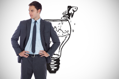 Serious businessman with hands on hips against fish out of water illustration illustration