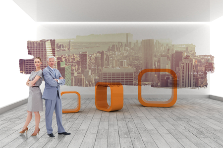 Serious businessman standing back to back with a woman  against abstract screen in room showing cityscape Imagens