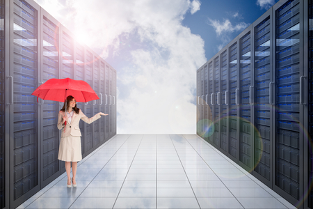 Attractive businesswoman holding red umbrella against server hallway in the sky photo