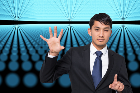 Composite image of unsmiling businessman holding and pointing photo